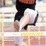 Sam Smith Burlington senior Gideon George attempts to clear the hurdle in the 110-meter hurdles Saturday in Cowley. George set a new school record in the event with a winning time of 15.39 seconds.