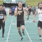 David Peck photo    Rocky Mountain senior Branson Robison and Big Horn sprinter Carson Bates are neck-and-neck near the finish line during the 100-meter dash finals Saturday in Casper. Robison edged Bates in a photo finish to win the event. At the left is Luis Navarro of Wright.