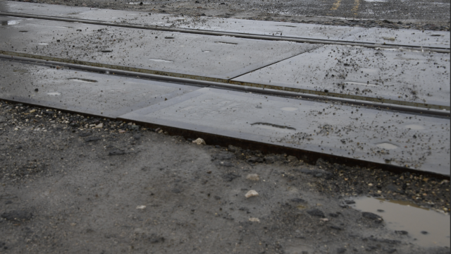 David Peck photo    Fill material at the railroad crossing in Deaver has washed away, leaving a hefty lip at the crossing. Town officials would like to see a tapered concrete or asphalt approach to the tracks.