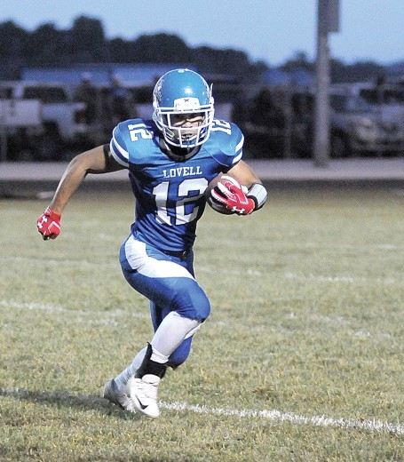 David Peck photo   Lovell junior Amos Monterde bursts to the outside for a gain during the Bulldogs' win over Thermopolis Sept. 25.