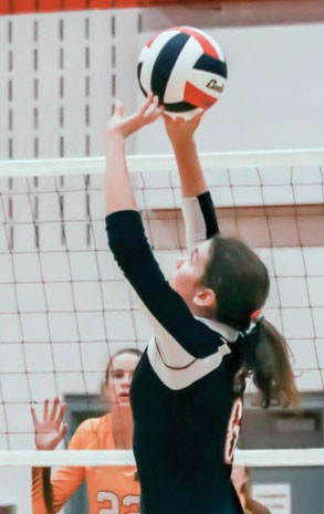 RHS Lady Rebel Volleyball Player Alysha Mendenhall sets the ball during a match against Rocky Mountain Grizzlies on Sept. 17.  Tammy Keele photo