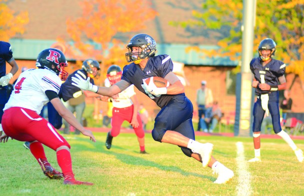 Jesus Hernandez hits the hole running during first-half action against Riverside Friday evening.