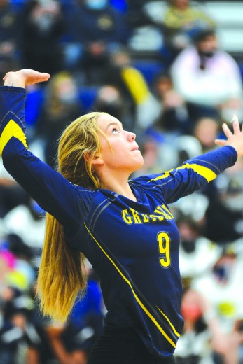 Mallory Brown serves to Rocky Mountain Friday at Buff Gym.